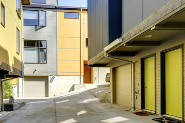 Yellow residential building with siding trim