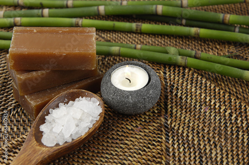 salt in wooden spoon bamboo grove on straw mat