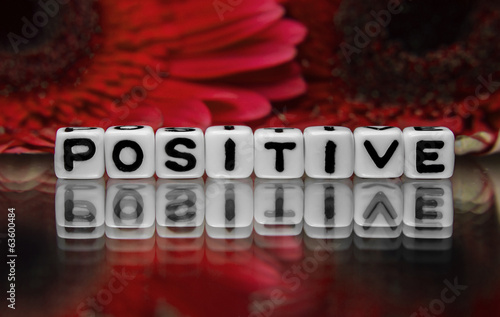 Positive text with red flowers