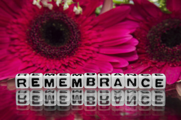 Remembrane text with flowers