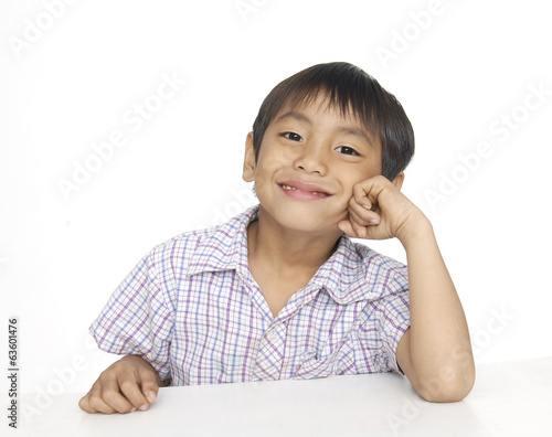 little boy with hands near his face isolated