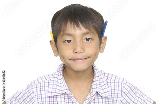 Little boy with color pencils over a white background