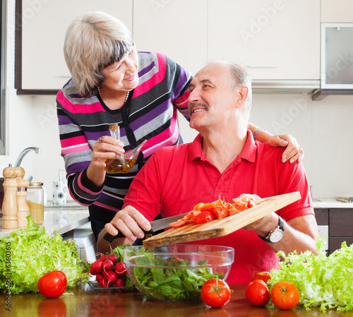 Smiling senior couple cooking  together