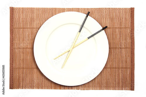 White plate on a bamboo mat