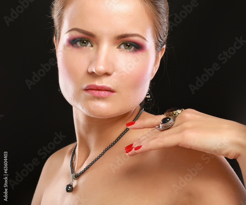 Portrait of pretty young woman with beads