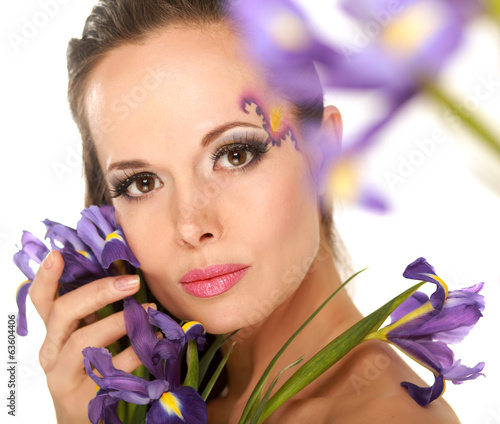 Beautiful woman with flower iris.