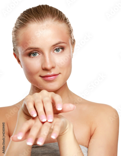 Young woman putting cream on her hand