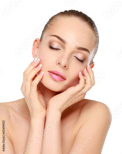 Young woman touching her face isolated on white background.