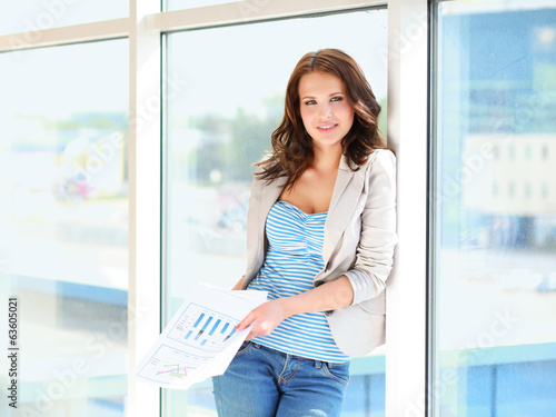 business woman in modern glass interior.