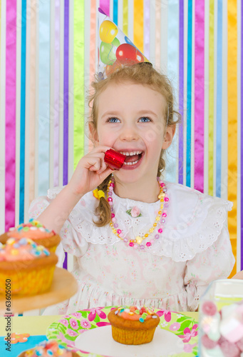 Adorable little girl celebrates her birthday.