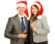 Young businesspeople in santa hat drinking champagne