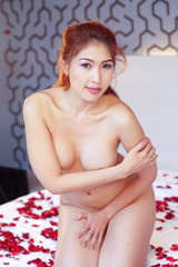Sexy woman neaked, posing on the bed