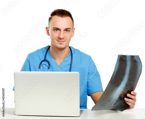 Male doctor with X-ray picture isolated on white background
