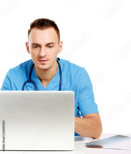 A male doctor working at a workplace
