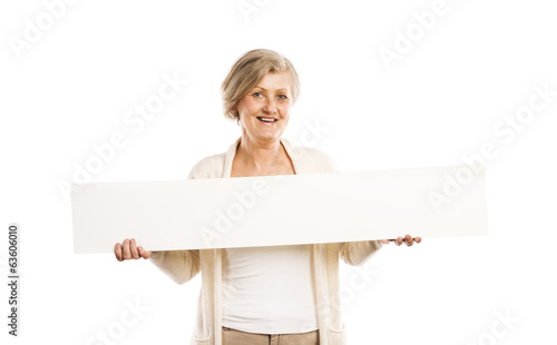 Senior woman with advertising board