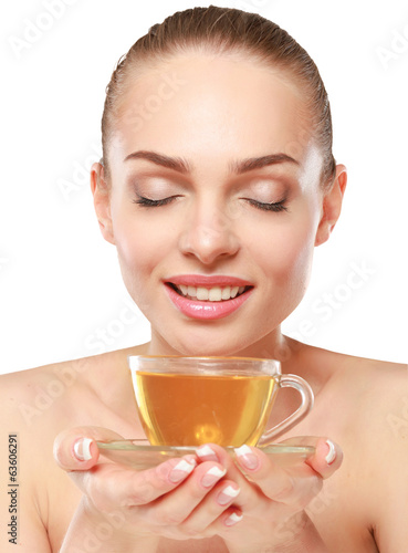 portrait of a beautiful woman drinking tea