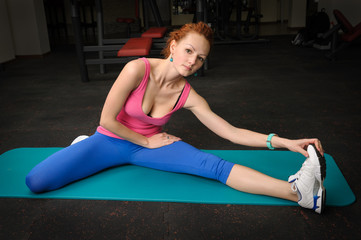 girl stretching in gym