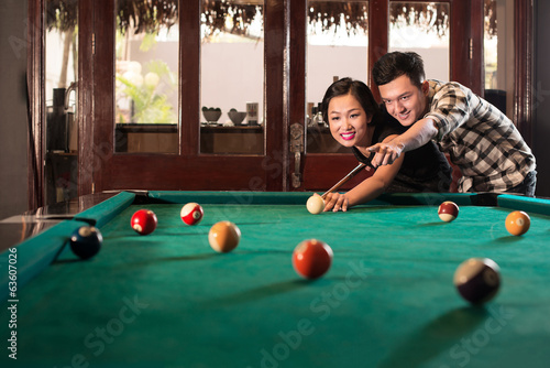 Vietnamese couple playing pool