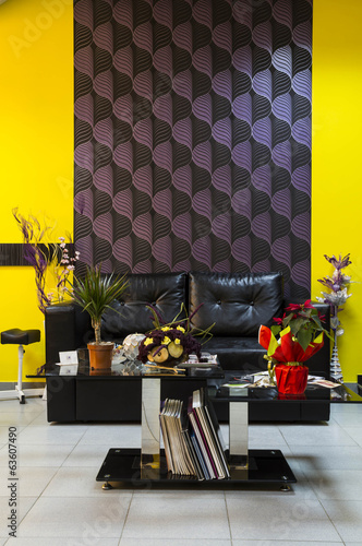 leather sofa with covering  in interior with ornament wallpaper