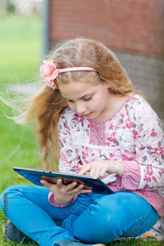 young girl with tablet