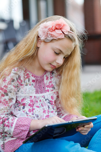 canvas print picture young girl with tablet