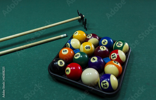 Billiard balls with cue.