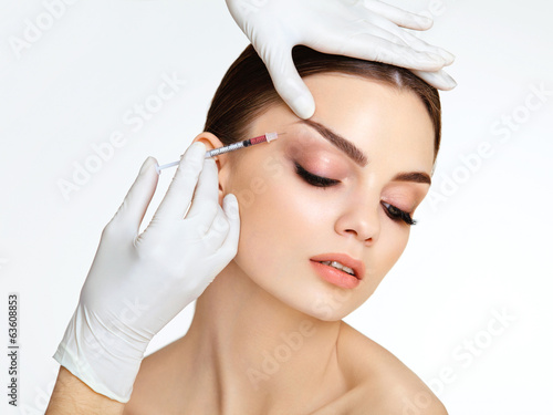 Beautiful woman gets injections. Cosmetology. Beauty Face - 63608853
