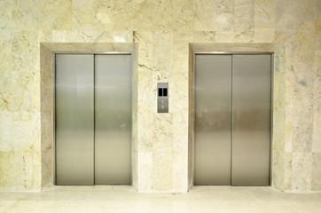 Hallway view of a modern closed elevator..