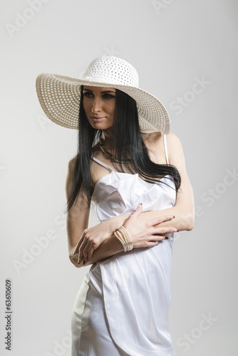 Pretty Caucasian woman in white dress