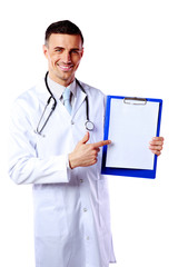 Cheerful male doctor holding empty clipboard