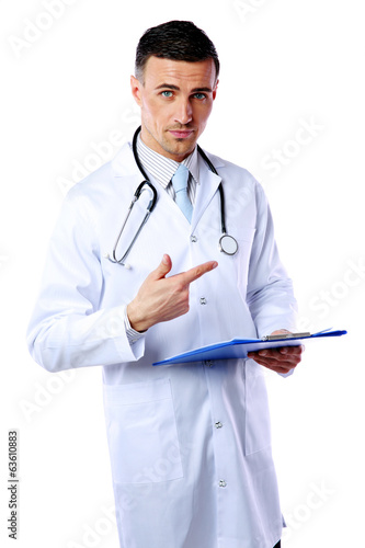 Confident male doctor with clipboard standing