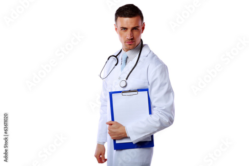 Confident male doctor holding empty clipboard