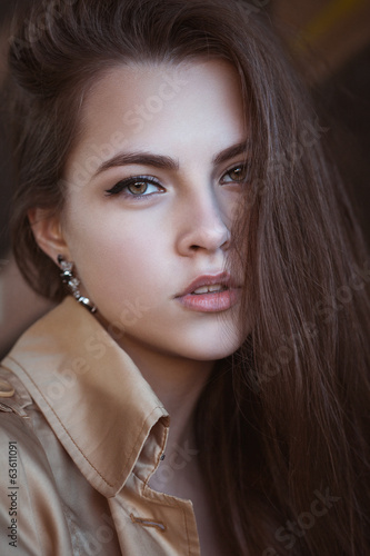 Portrait of a beautiful young woman in casual elegance style