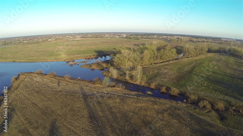 Beautiful panorama of   blue morning river and wood. Aerial
