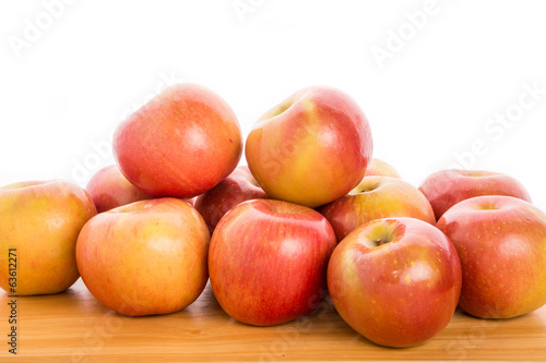 Bunch of Apples on Wood Table with White Background