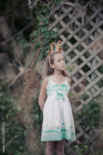 young girl with giraffe ears
