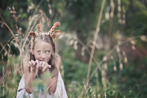 young girl with giraffe ears, stalking