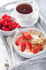 granola with strawberry for breakfast