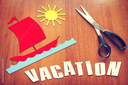 Paper scraps about Vacation on the table