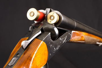 Opened double-barrelled hunting gun with two cartridges
