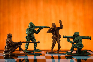 soldier, toy, game, orange background, chess board