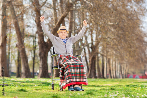 Elderly gentleman gesturing happiness in park