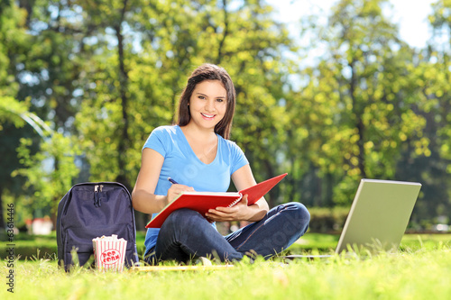 Female student relaxing in park