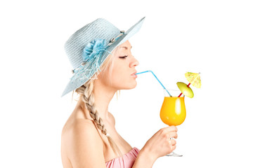Girl drinking a cocktail with a straw