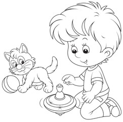 Boy plays with a whirligig and kitten