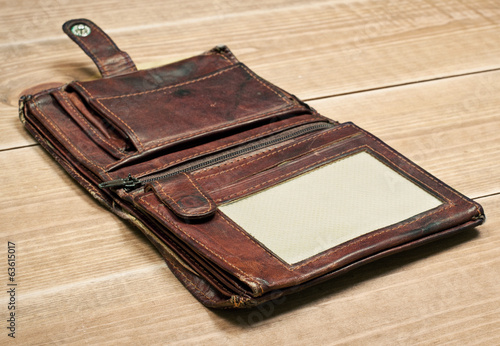 Opened old wallet on wooden table