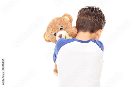 Little boy hugging a teddy bear