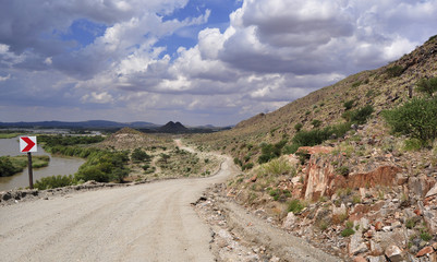 Dirt road through arid African landscape along Orange river