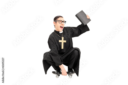 Male priest riding a small skateboard