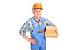 Mature construction worker holding boxes